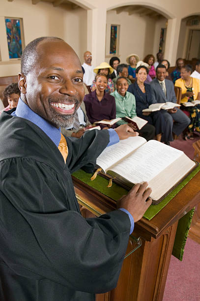 preacher talking to his congregation in church - preacher stock photos and pictures