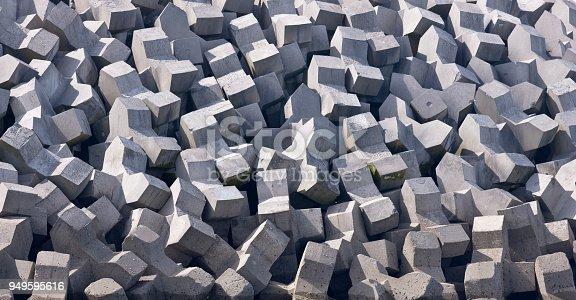 istock Precast concrete armor units on North Atlantic Jetty, Inishmaan 949595616