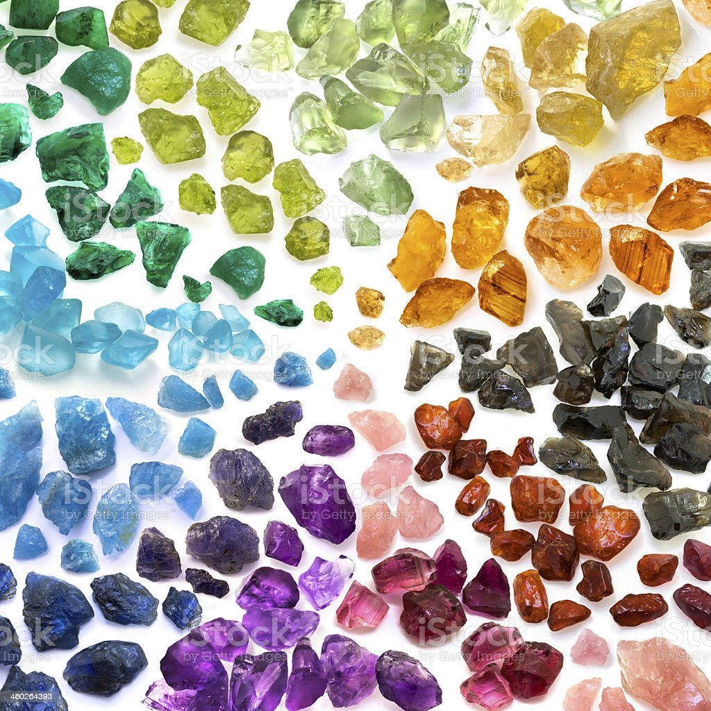 Precious and semiprecious gems in color spectrum stock photo