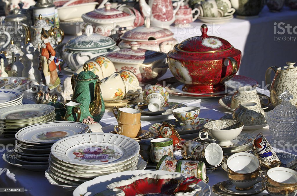 precious antique furnishings and retro ceramic plates stock photo