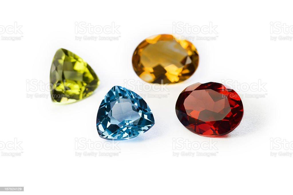 Precious Gemstones Garnet Imperial Topaz Ruby and Sapphire stock photo
