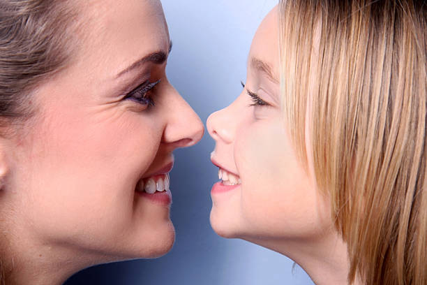 Royalty Free Two Girls Nose To Nose Pictures, Images and ...