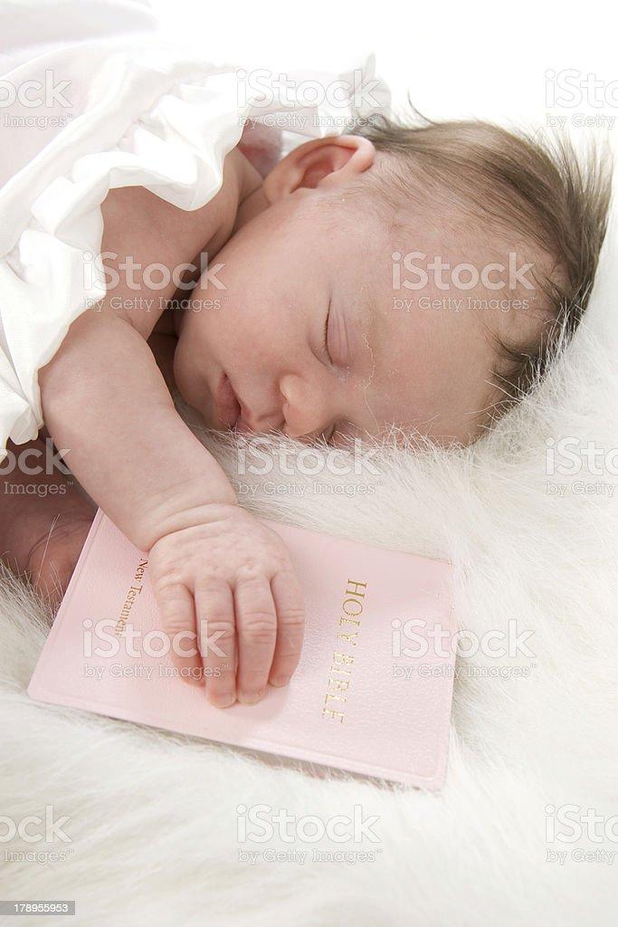Precious Newborn Sleeping Faithfully with Bible royalty-free stock photo