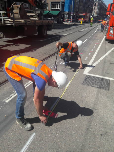 Precise measuring of the road always matters. stock photo