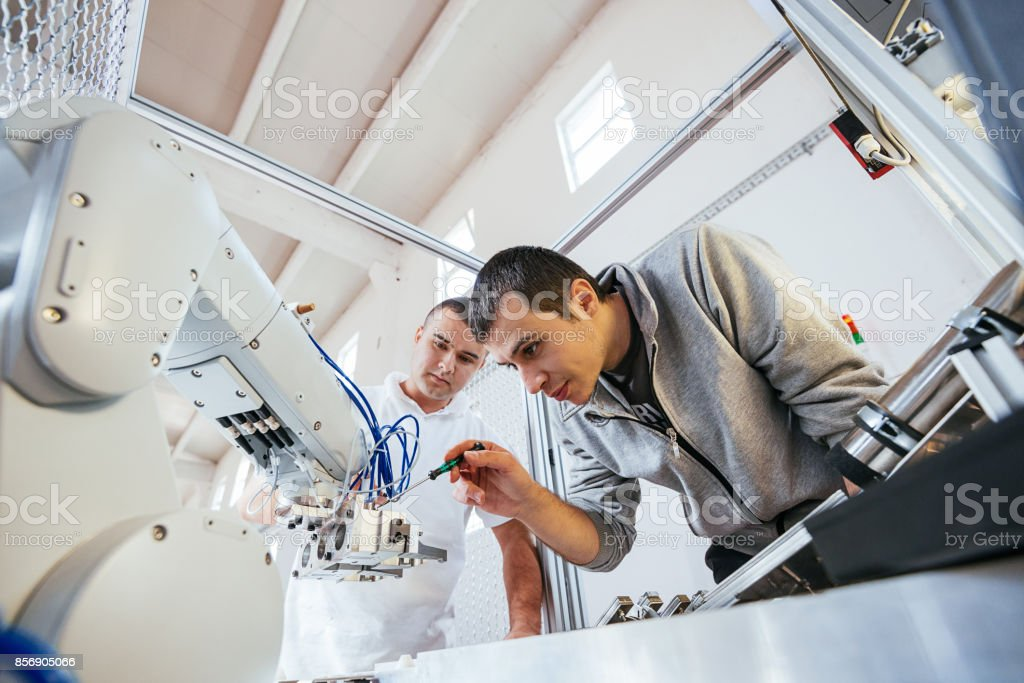 Precise mechanics on robotic arm in industry stock photo