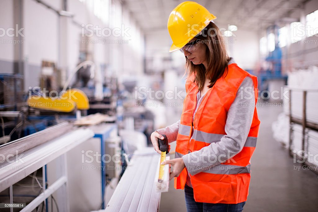 precise work in a factory stock photo