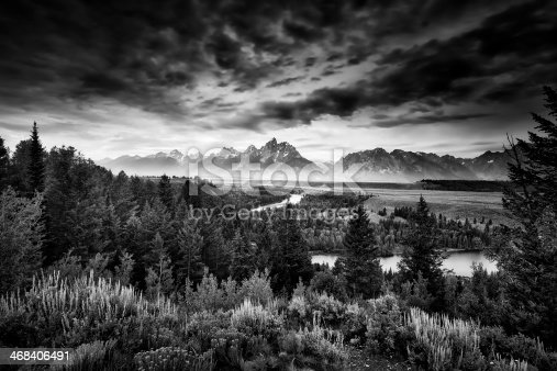 Misty pre-dawn view of the Snake River Valley in the Tetons