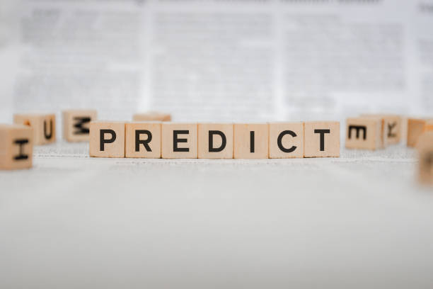 Predict Word Written In Wooden Cube - Newspaper stock photo
