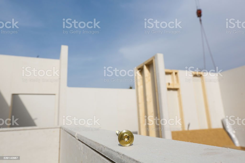 Prefabricated house in the making with screw stock photo