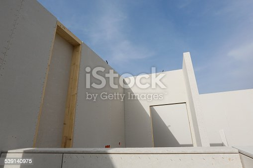 istock Prefabricated roofless house in the making 539140975