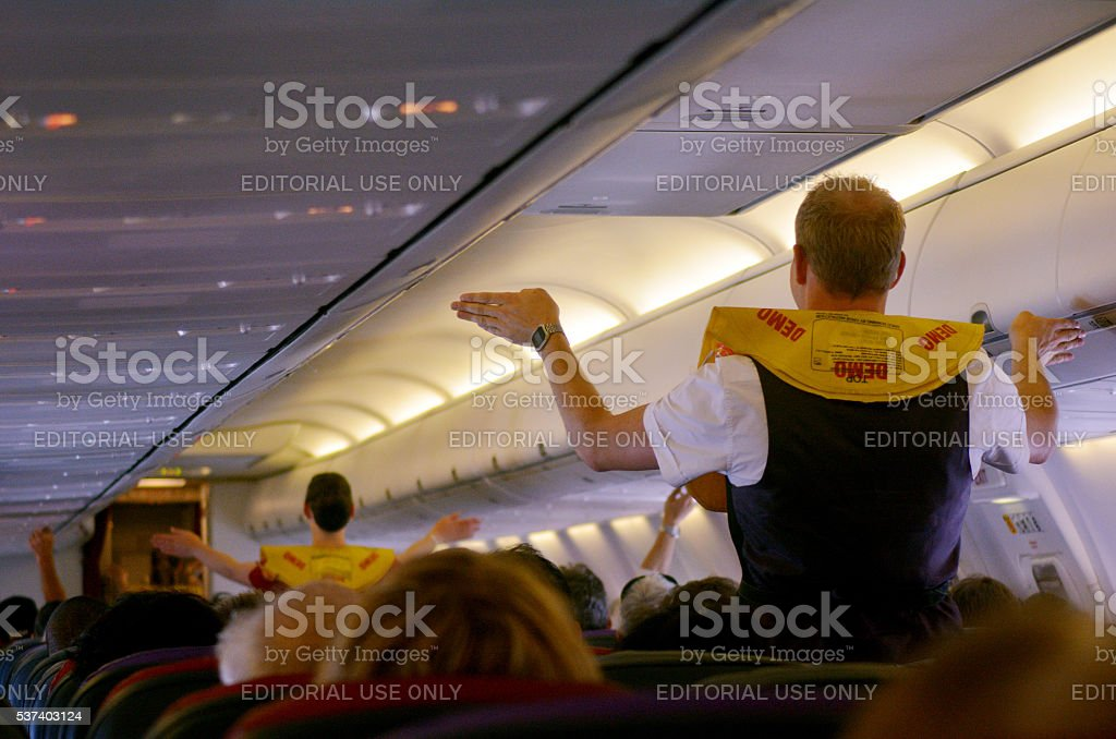 Pre-flight safety demonstration stock photo