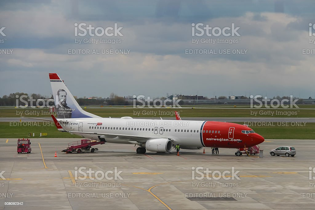 Preflight service of the Norwegian Airlines plane in Warsaw stock photo