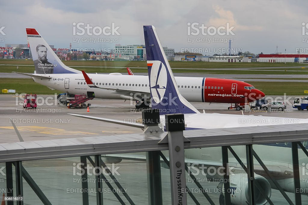 Preflight service of the Norwegian and Polish Airlines planes stock photo