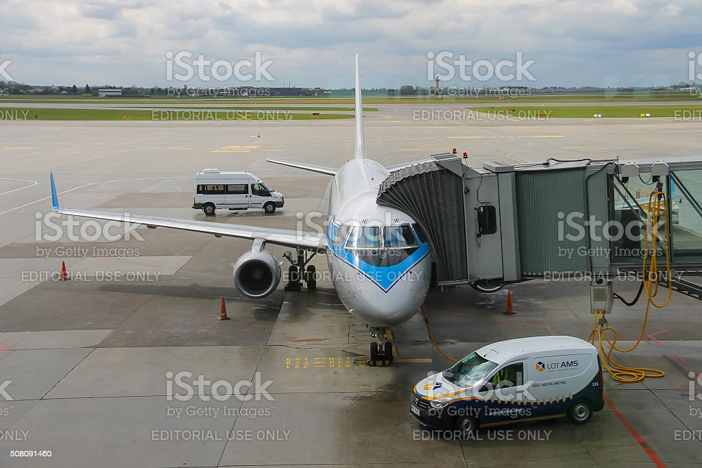 Preflight service of the plane in Warsaw Chopin Airport, Poland stock photo
