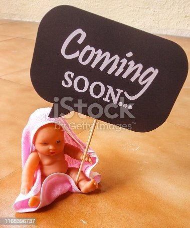 istock pregnancy announcement or maternity photo-shoot 1168396737