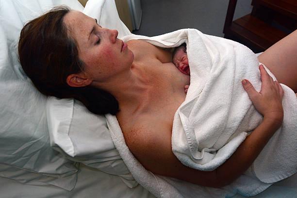 Pregnancy - pregnant woman and newborn - Photo