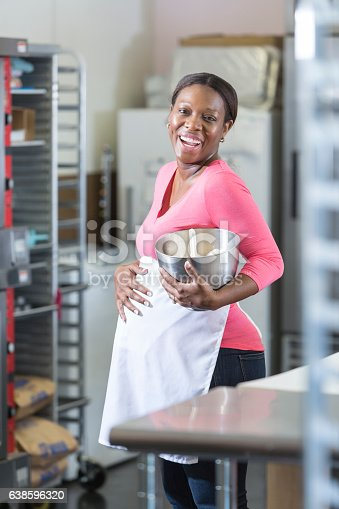 istock Pregnant, African American woman working in bakery 638596320