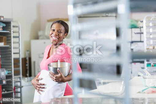 istock Pregnant, African American woman working in bakery 639242444