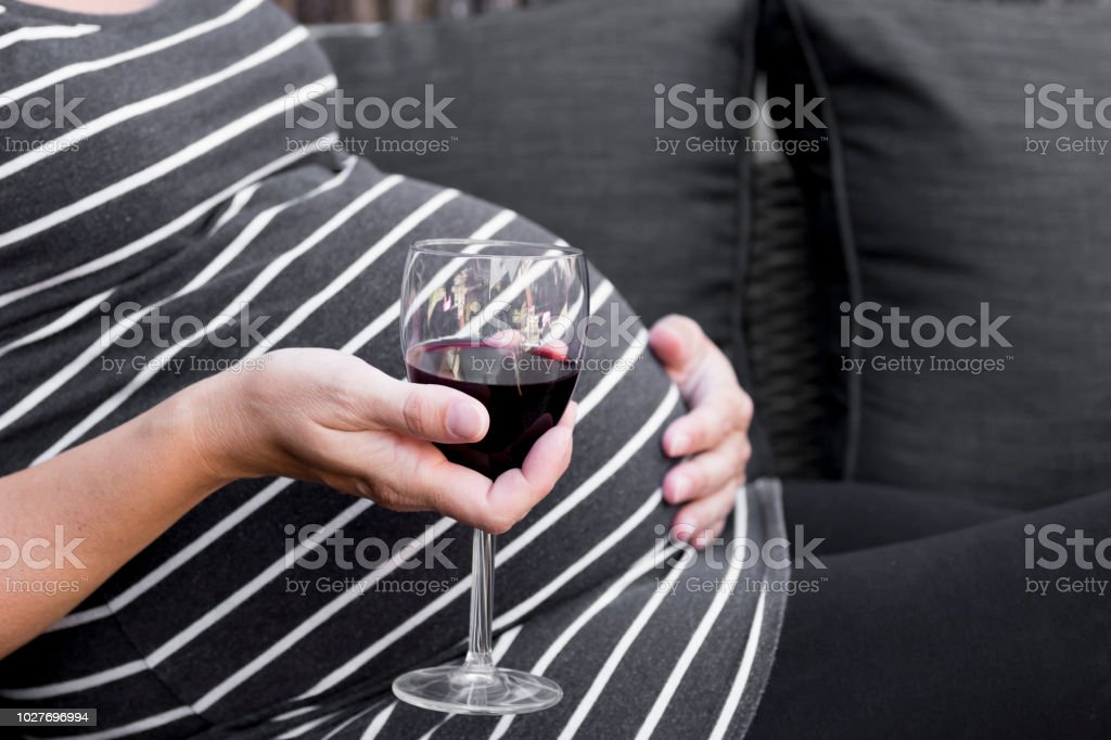 Pregnant and alcohol stock photo