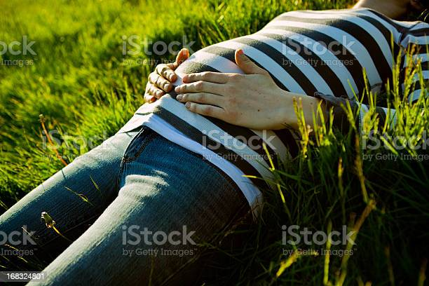 Pregnant Belly At Sunset Stock Photo - Download Image Now