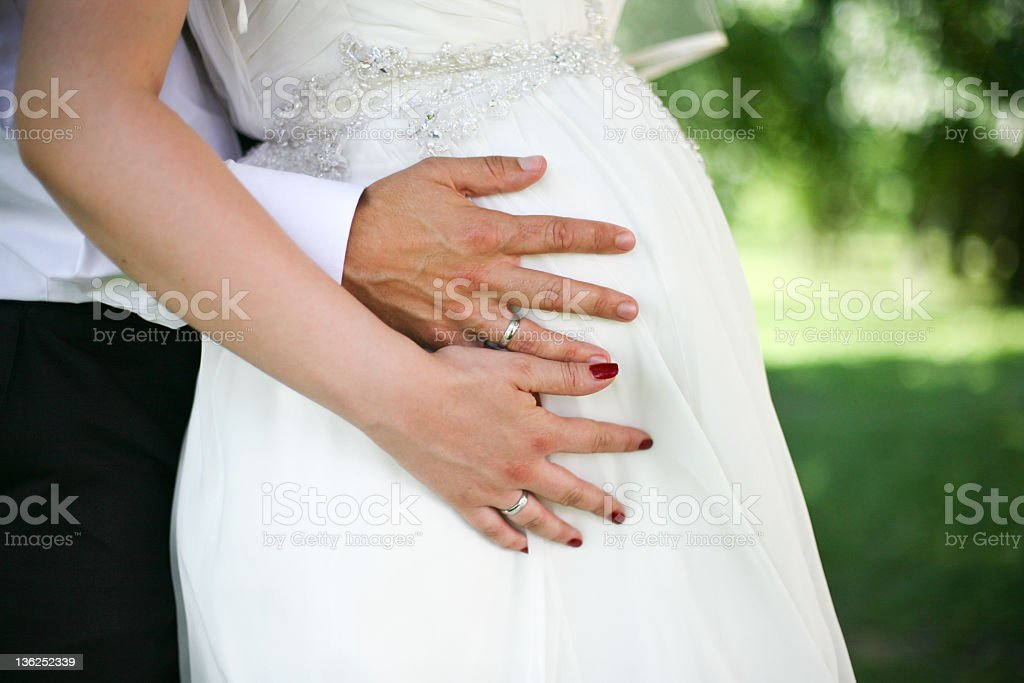 Pregnant bride stock photo