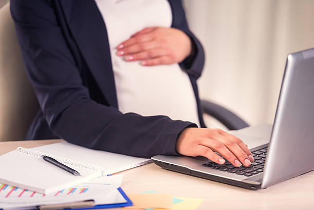 pregnant business woman - leaving stock photos and pictures