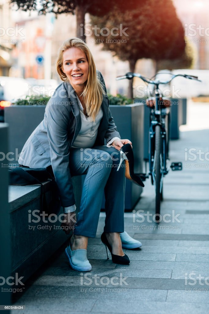 Pregnant Businesswoman using smart phone stock photo