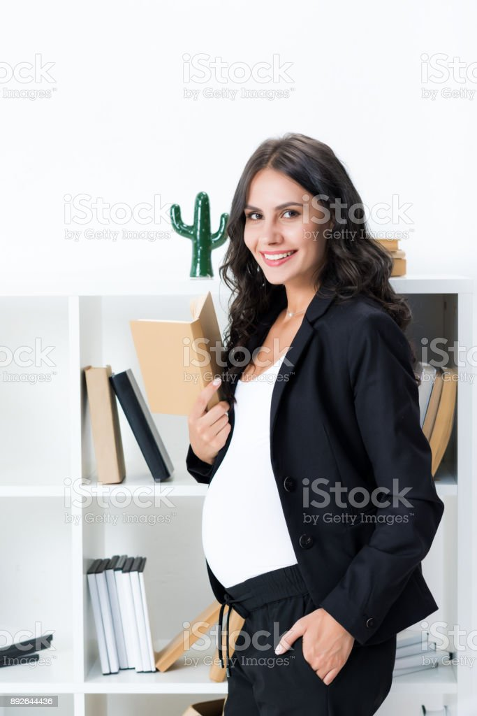 pregnant businesswoman with book stock photo
