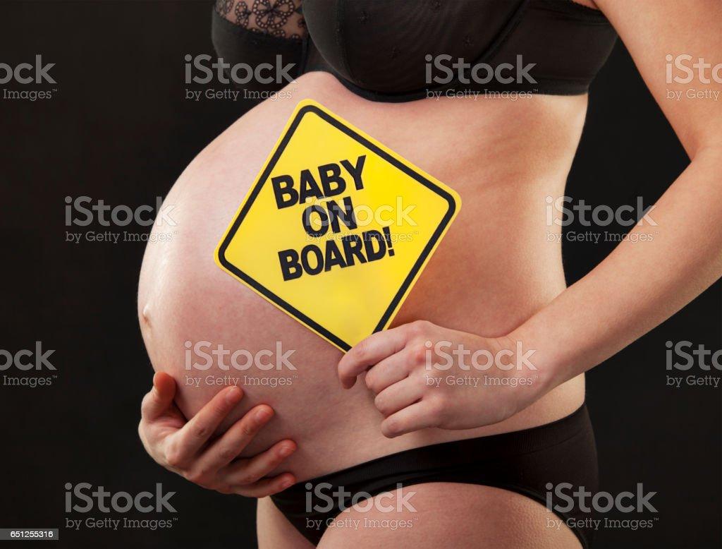 pregnant close abdomen sign stock photo