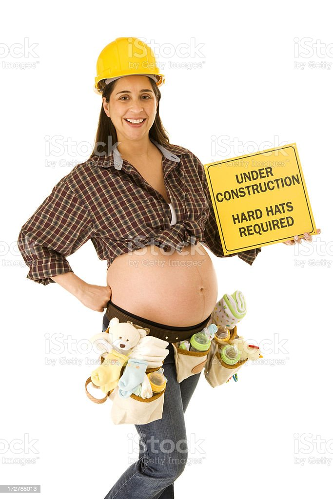 Pregnant Construction Worker with Sign stock photo