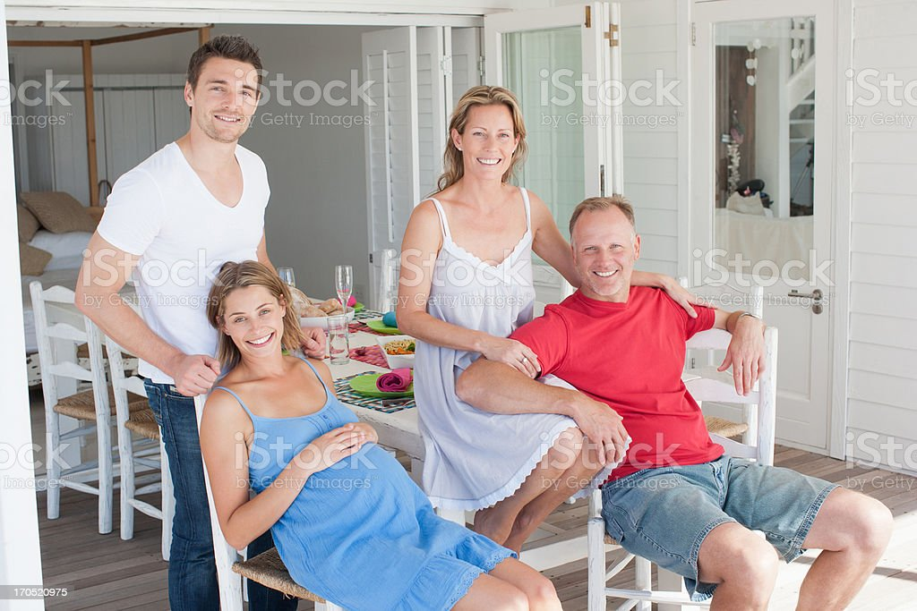 Pregnant couple and friends having breakfast royalty-free stock photo