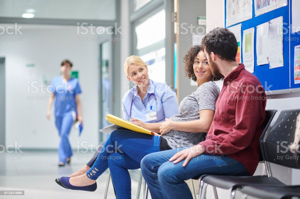 pregnant couple at clinic stock photo