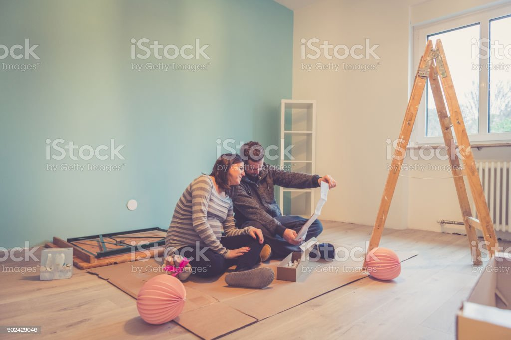 Pregnant couple in a new home stock photo