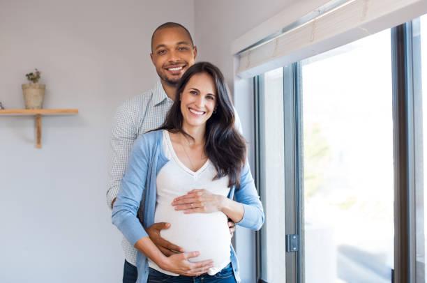 Pregnant couple loving stock photo