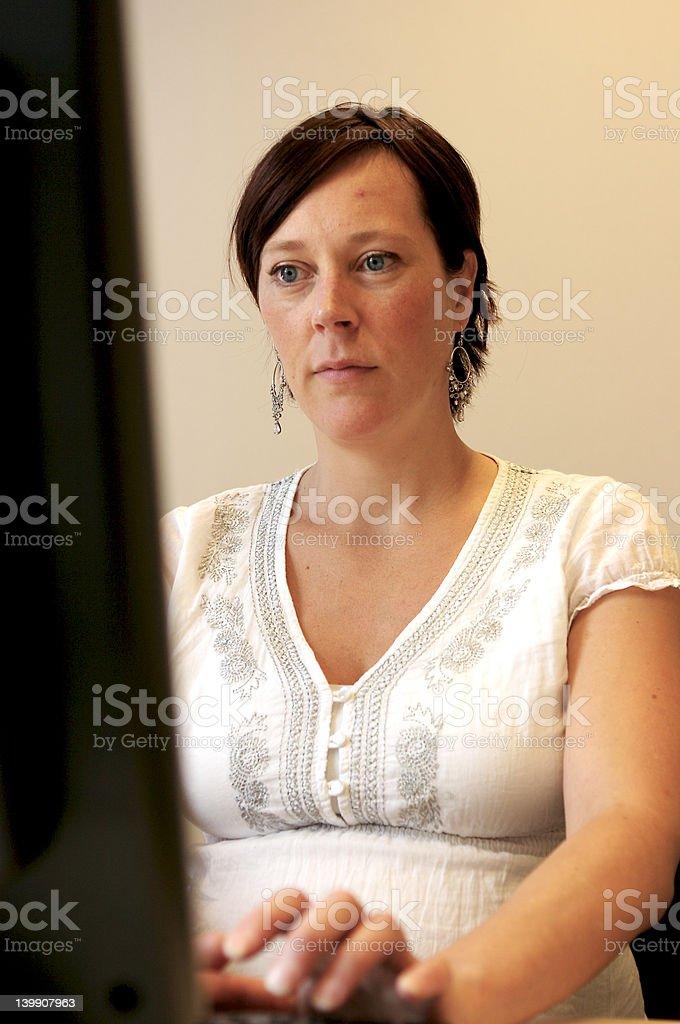 Pregnant employee computing royalty-free stock photo