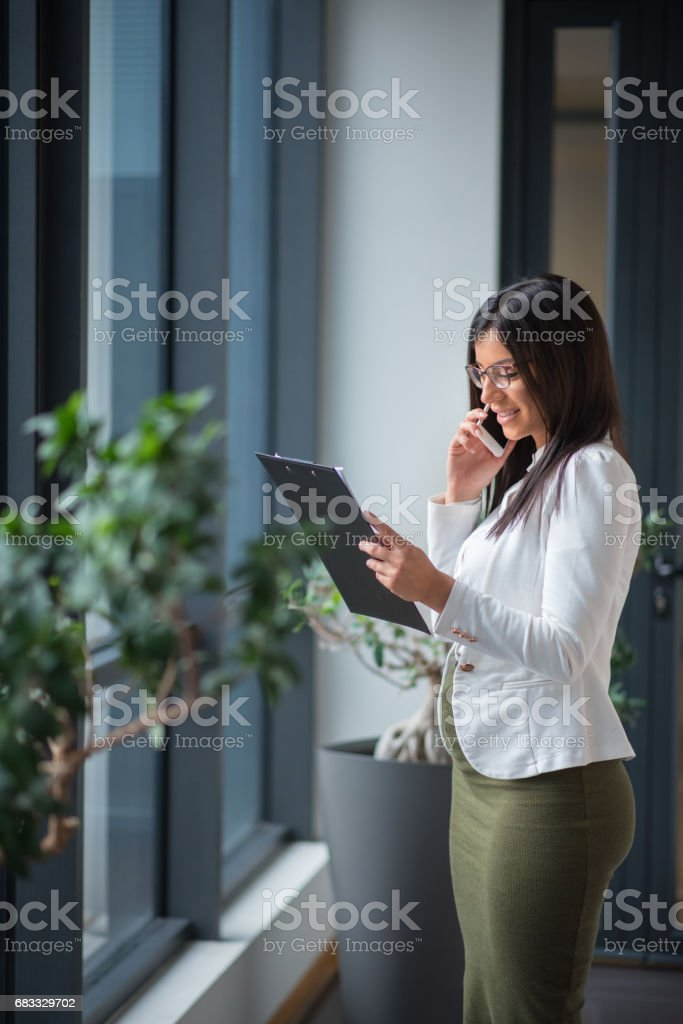 Pregnant employee working in office royalty-free stock photo