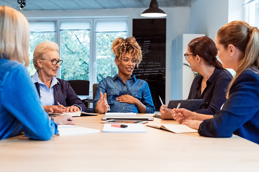 Pregnant Expertise Talking With Colleagues At Desk Stock Photo - Download Image Now