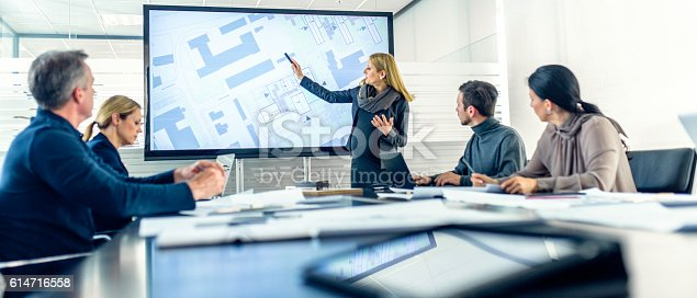 istock Pregnant female architect having a presentation 614716558
