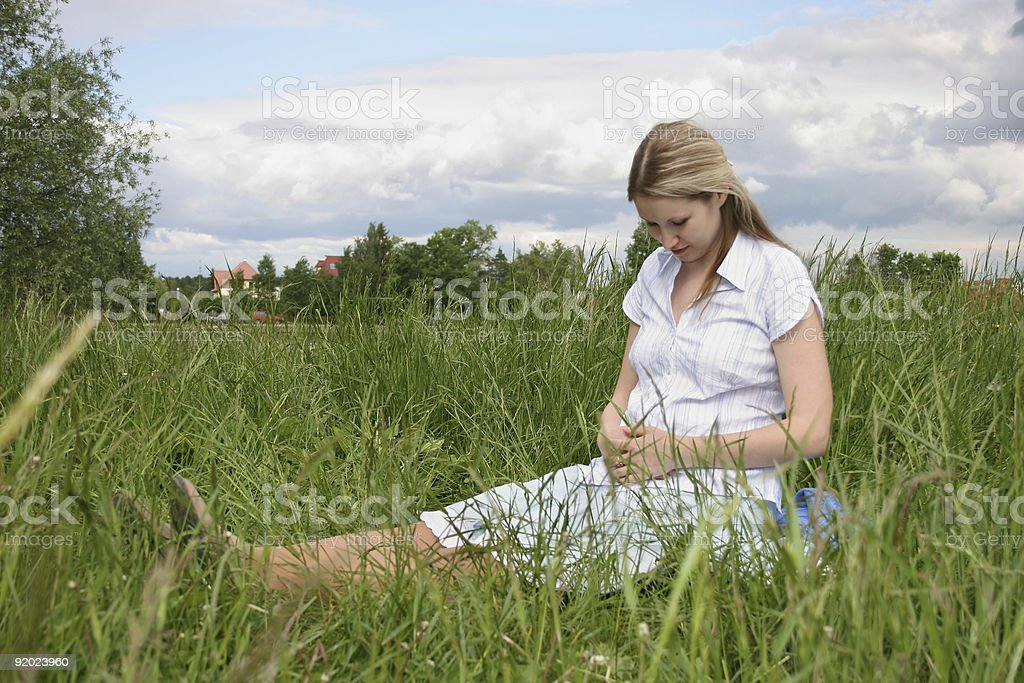 pregnant girl on meadow 2 stock photo
