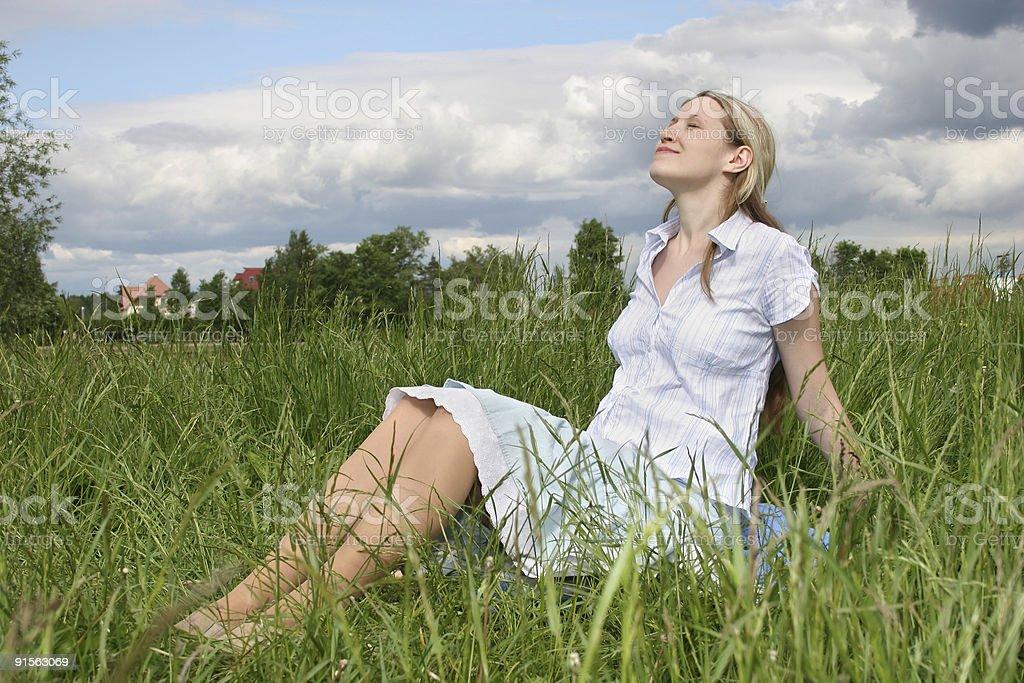 pregnant girl on meadow stock photo
