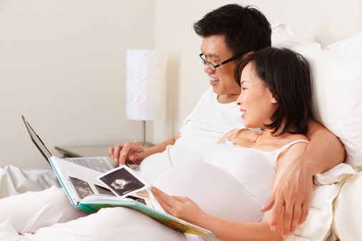 istock Pregnant lady and her husband spending time togeher 153702145