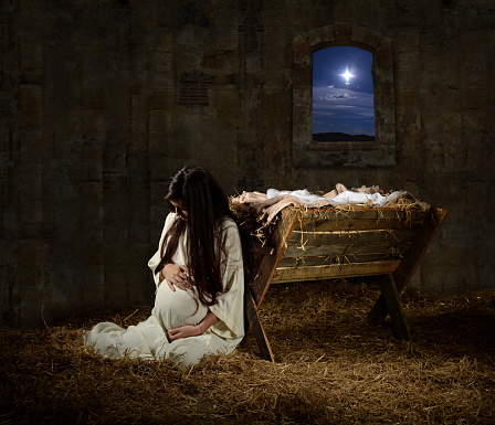 Pregnant Mary Leaning On Manger Stock Photo - Download Image Now