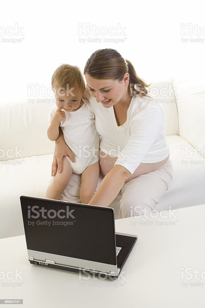 Pregnant mother using laptop royalty-free stock photo