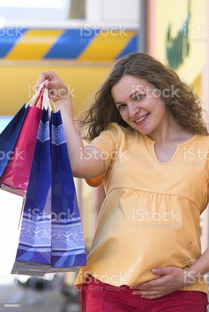 Pregnant shopper royalty-free stock photo
