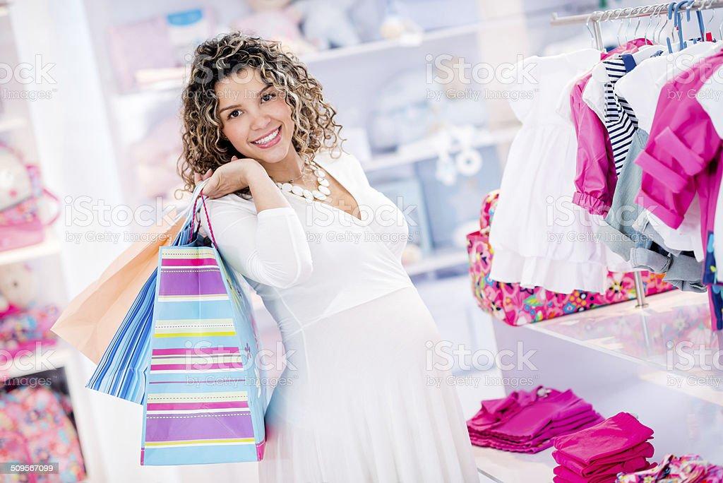 Pregnant shopping woman stock photo