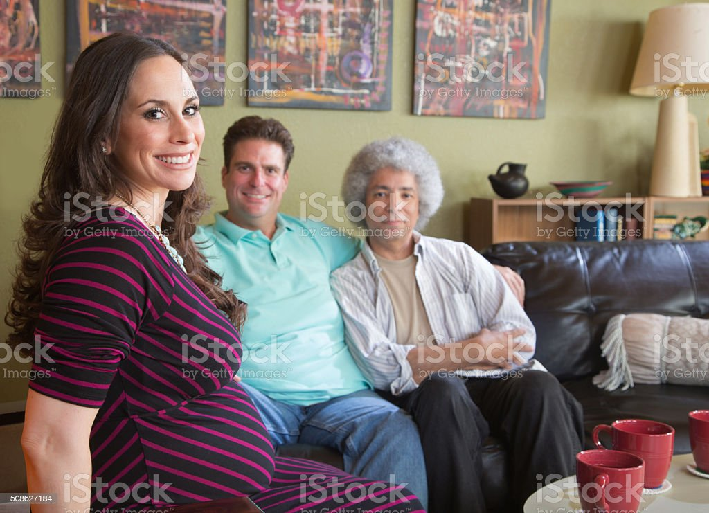 Pregnant Surrogate Mom with Couple stock photo