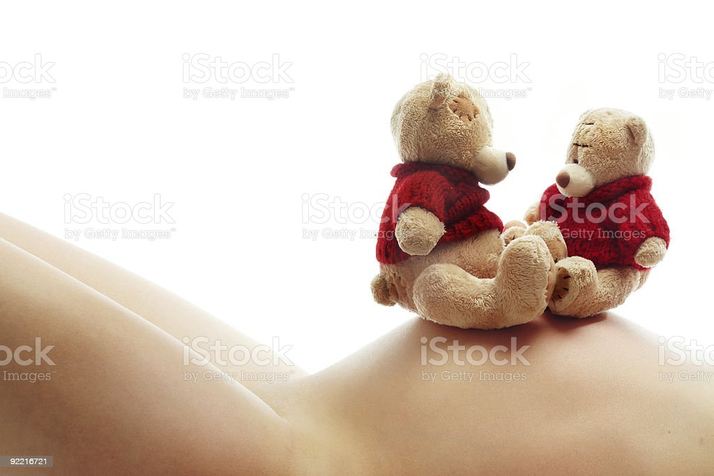 Pregnant woman and teddy bears royalty-free stock photo