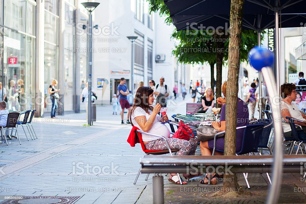 Pregnant woman at cafe royalty-free stock photo