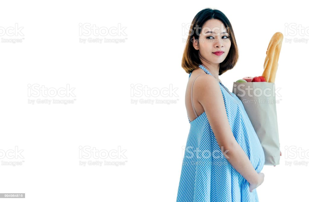 Pregnant woman carrying a food bag. White background stock photo