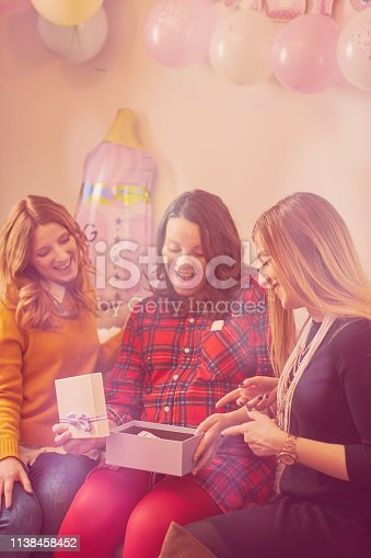 istock Pregnant woman celebrating baby shower party with friends. 1138458452